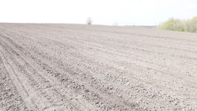 Tractor with planter. Turn and goes to the horizon stock footage