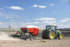 Tractor Planting Seed In Field. Tractor Planting Seed In a large Field Royalty Free Stock Photography