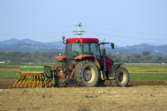 Tractor planting seeds Royalty Free Stock Photos