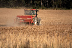 Tractor with plough. Big tractor ploughing a field Royalty Free Stock Photos