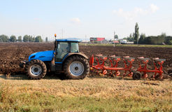 Tractor with plough Stock Photography