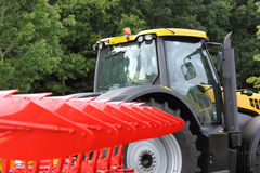 Tractor and plough Royalty Free Stock Image