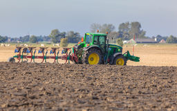 Tractor with Plough in the Field Stock Images