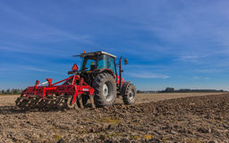 Tractor with Plough at Work Stock Image