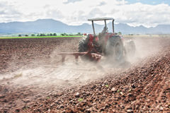 Tractor ploughing Stock Photos
