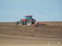 Tractor ploughing agricultural land Royalty Free Stock Photography