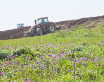 Tractor ploughing agricultural land Royalty Free Stock Photo