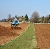 Tractor Ploughing a field Stock Image