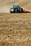 Tractor ploughing field Royalty Free Stock Image