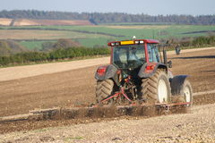 Tractor ploughing field Stock Images