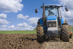 Tractor ploughing field Royalty Free Stock Photography