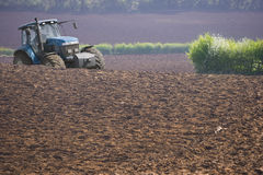 Tractor ploughing field Royalty Free Stock Photos