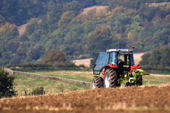 Tractor ploughing field. In an English landscape Stock Photos