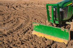 Tractor ploughing a field Stock Photo