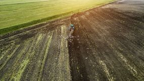 Tractor ploughing field aerial photography with drone royalty free stock image