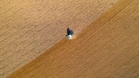 Tractor ploughing a field in the french countryside Stock Photos