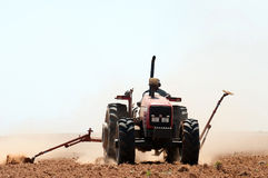 Tractor ploughing a field Royalty Free Stock Photo