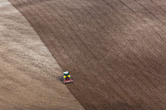 Tractor ploughing a field Stock Photos