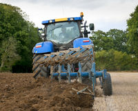 Tractor Ploughing Field Rear View Stock Photo