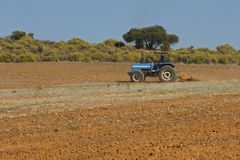 Tractor ploughing land Stock Photos