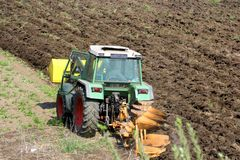 Tractor ploughing the land Royalty Free Stock Photography