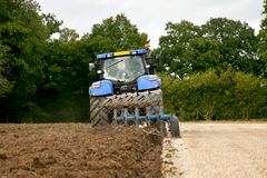Tractor Ploughing Rear View Stock Photos