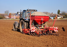 Tractor Ploughing and spreading fertiliser Royalty Free Stock Images