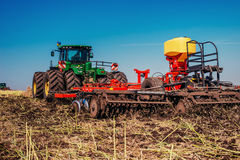 Tractor ploughing up the field. Royalty Free Stock Images