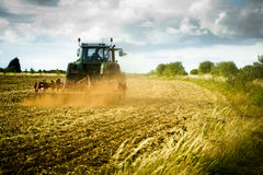 Tractor Ploughs Field Stock Photo