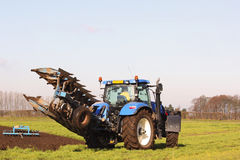 Tractor and plow Stock Photos
