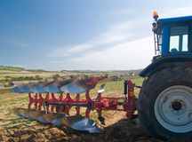 Tractor with plow Stock Image