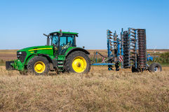Tractor with plow agricultural implement Royalty Free Stock Photos