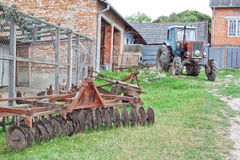 Tractor and plow on the farm. Stock Images