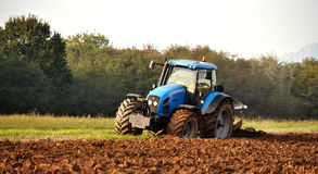 Tractor and plow in field stock images