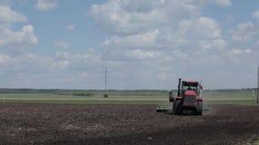 Tractor plow field near forest in summer. stock footage