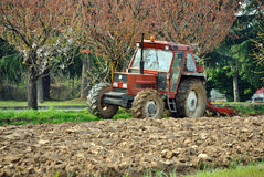 Tractor and plow in field royalty free stock photos