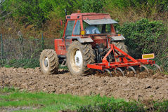 Tractor and plow in field Stock Image
