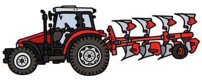 Tractor with a plow Stock Images