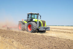 Tractor with a plow Stock Photography