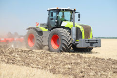 Tractor with a plow Royalty Free Stock Photos
