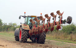 Tractor and plow or plough. Royalty Free Stock Image