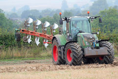 Tractor and plow or plough. Stock Photography