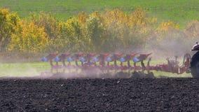 Tractor plow plowing field stock video