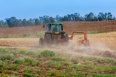 Tractor plow the soil. Stock Photos