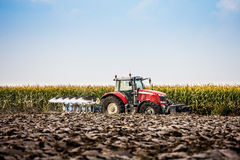 Tractor and plow Stock Photography