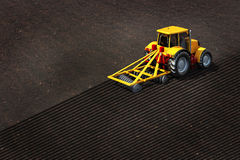 Tractor plowed empty field. 3d illustration of tractor plowed empty field Stock Image