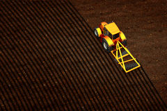 Tractor plowed empty field. 3d illustration of tractor plowed empty field Stock Photography