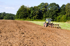Tractor plowed farm field Stock Photography