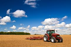Tractor in plowed field Stock Photography