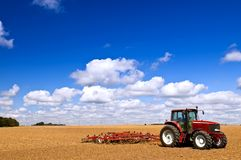 Tractor in plowed field Royalty Free Stock Image